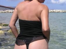 String dans le cul à la plage